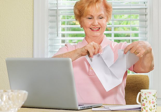 senior woman working with laptop and finances