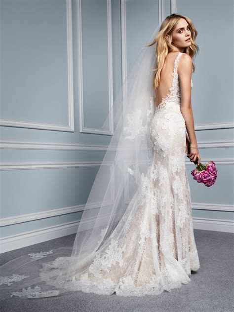 Monique Lhuillier wedding dress with low back.   Marry Me