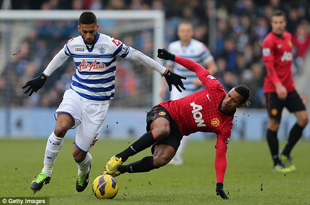 Stop there: Nani tackles Armand Traore during United's win