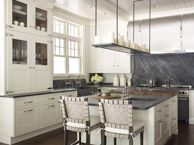 Ivory Kitchen Cabinets with Soapstone Countertop and Soapstone slab backsplash. Hickman Design Associates.