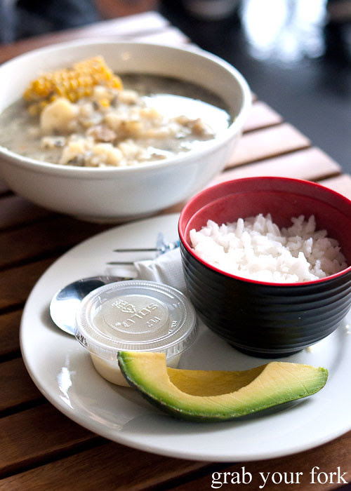 Avocado, rice and thickened milk cream sides to ajiaco soup at Colombia Organik Sydney