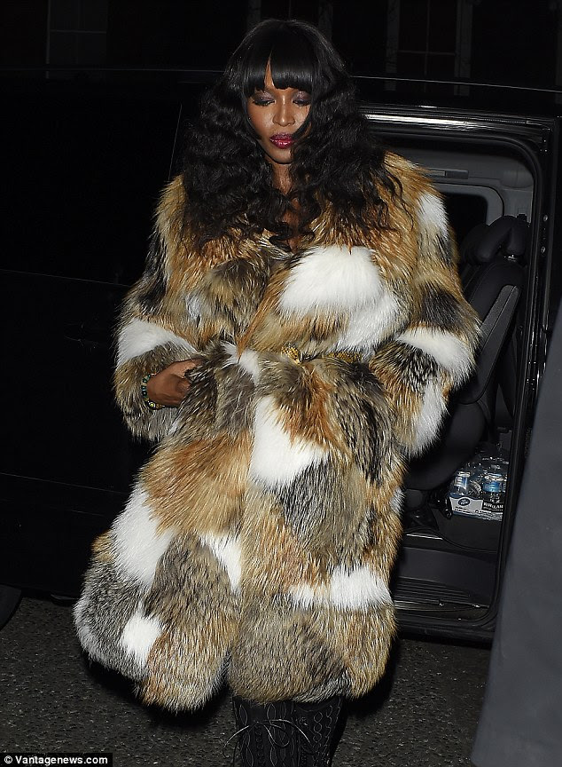 She is fur real: Naomi, 45, concealed most of her evening attire beneath a statement coat which was made from patches of different coloured fur