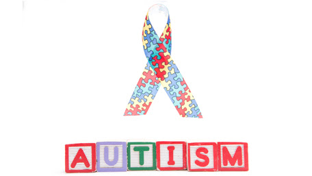 autism ribbon with blocks spelling out Autism