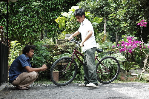 Ali (Zamir) knows that his dad, Budi is in trouble
