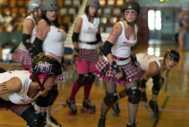 Precious N Metal and the rest of the Pink Pistols do warm up drills before the big bout
