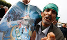 A supporter holds a picture of Libya's leader Muammar Gaddafi in Sabratha