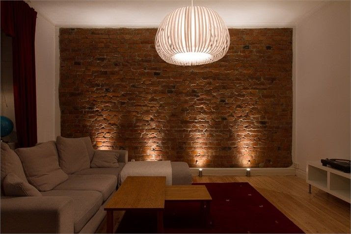 exposed brick lit from the bottom