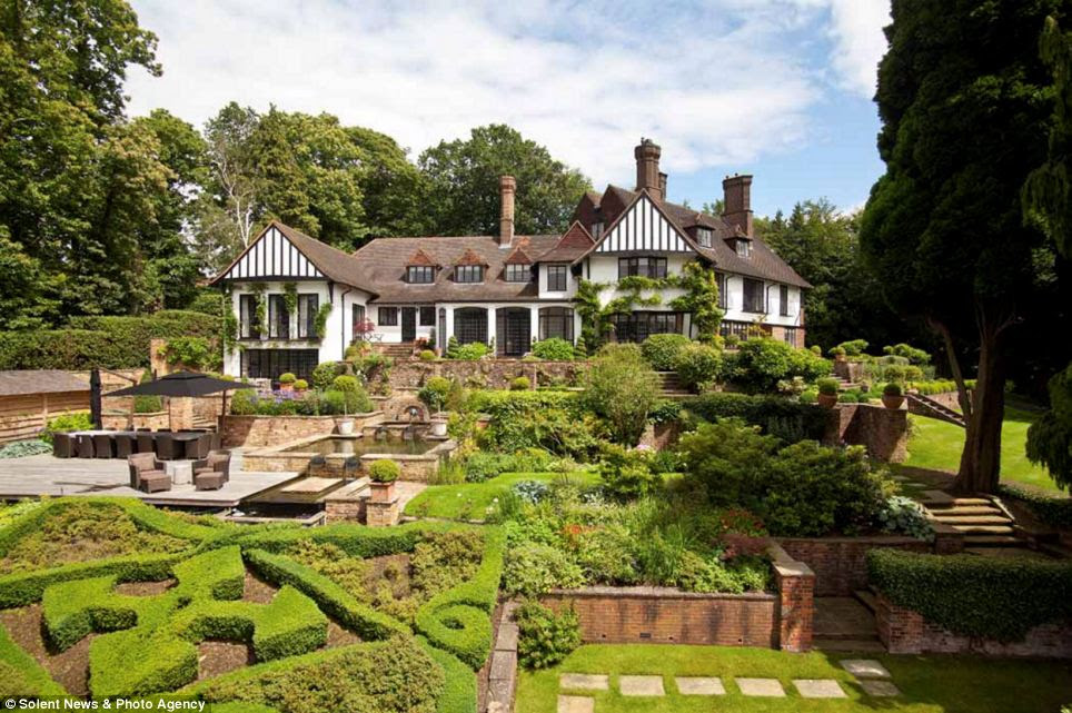 Up for sale: Kenwood, the former home of John Lennon, is on the market for nearly £14million