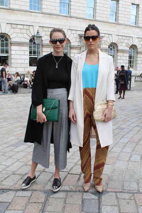 Micaela (left) wears: Shades: Prada, Jacket: Topshop, Bag: Bulgari, Shoes: Miu Miu, Trousers: Topshop, Top: Dolce & Gabbana