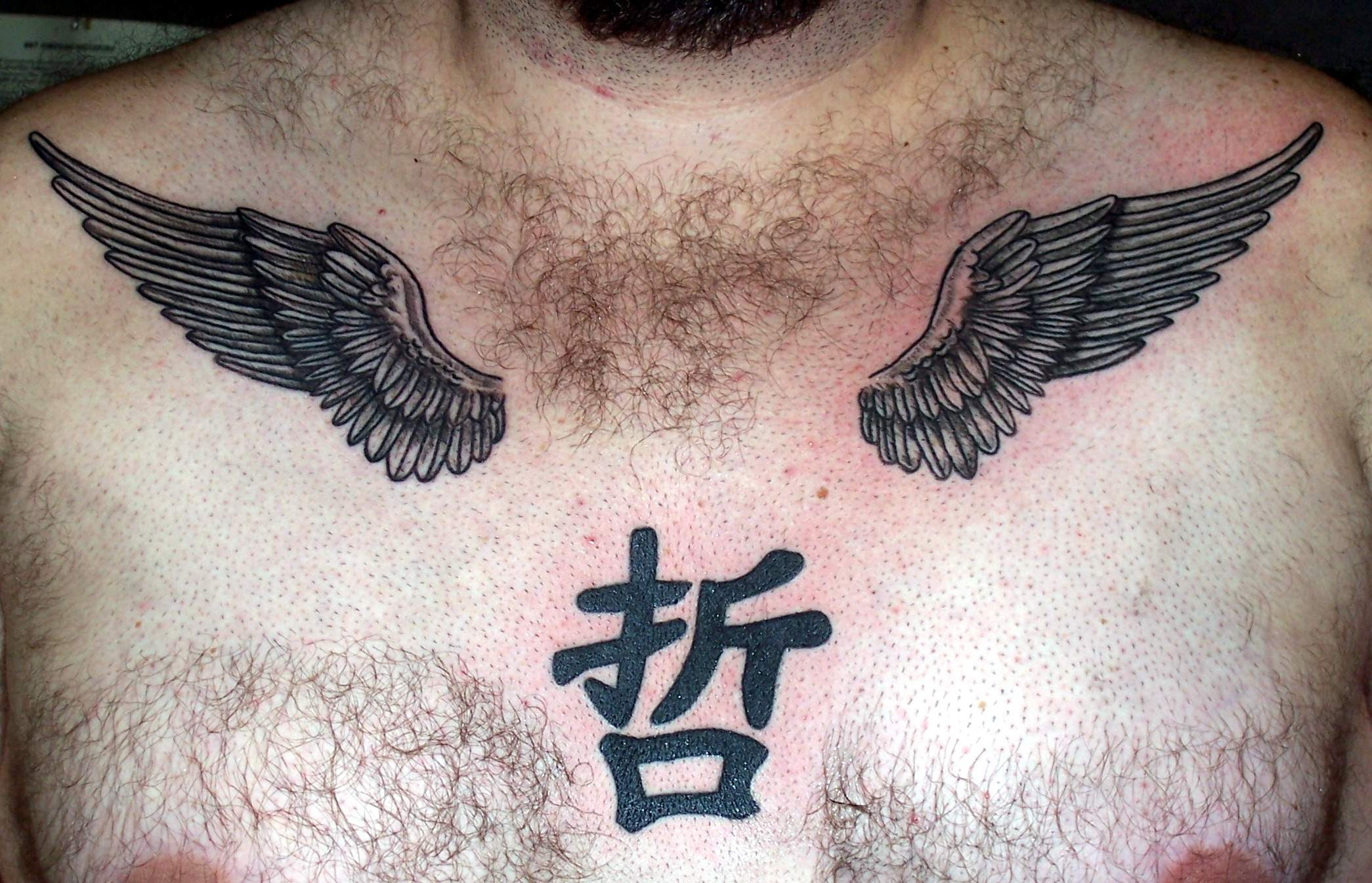 Eagle Wings Tattoo On Chest