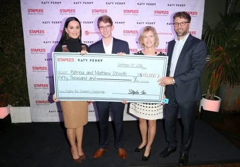 Global superstar Katy Perry and Staples for Students Sweepstakes grand prize winner Patricia O'Keefe and her son Matthew and William Durling of Staples, attend the sweepstakes Winners VIP Celebration on Thurs., Oct. 13, 2016, in Los Angeles. The sweepstakes grand prize included a $50,000 scholarship and a trip to Los Angeles with a guest to meet Katy Perry. In April, as part of the Staples for Students program, Staples partnered with Perry to announce a $1 million donation to DonorsChoose.org. As a result, Staples fulfilled 1,072 classroom projects on DonorsChoose.org, providing 787 teachers and impacting 98,609 students across the country. Additionally, Staples customers donated more than $330,000 to DonorsChoose.org at Staples stores and at http://ift.tt/28VbIXn throughout the back-to-school season. (Casey Rodgers/AP Images for Staples)