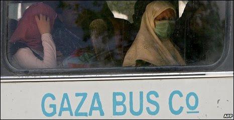 Palestinians wait to cross into Egypt through the Rafah border, 27/06