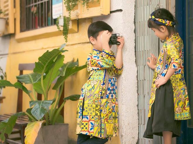 Không chỉ mỗi người lớn, nhiều hãng thiết kế Việt cũng giới thiệu tặng khá nhiều mẫu áo dài cách tân để các bé diện thật xinh xắn trong Tết này - Ảnh 7.