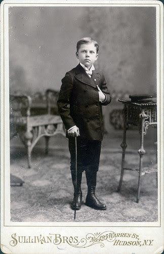 Boy in suit with cane