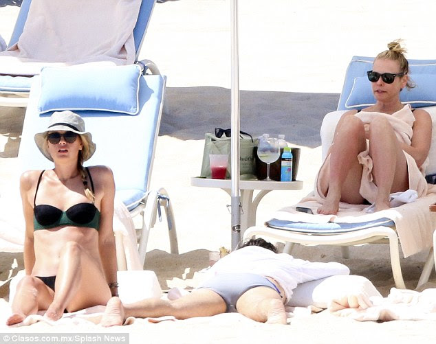 Bonding trip: Maria Sharapova and Chelsea Handler were spotted during a holiday in Los Cabos, Mexico on Sundaywith the chat show host stripping down to her bra after forgetting to pack her swimsuit