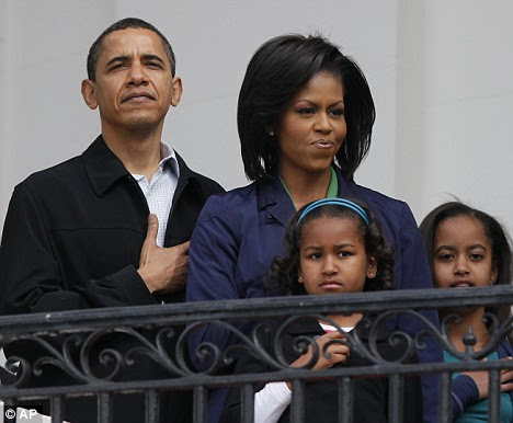 Barack Obama, pictured here celebrating Easter Monday with his family yesterday, has launched a major departure from George Bush's policies towards Cuba