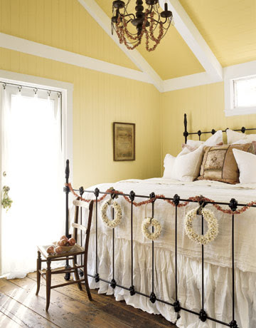 In the Andereggs' sun-washed bedroom, a gracious iron bed is dressed with crinkled linens -- Margo's preference. The center pillow is handcrafted from vintage fabrics; on the wall, a 1905 certificate memorializes the marriage of Sever and Vernie.