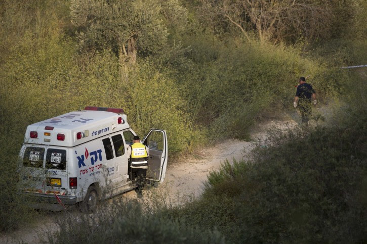 FILE - Policemen and volunteers of the search and rescue Zaka organization seen near the Jerusalem Forest where the body of Aharon Sofer was found, on August 28, 2014. Flash90