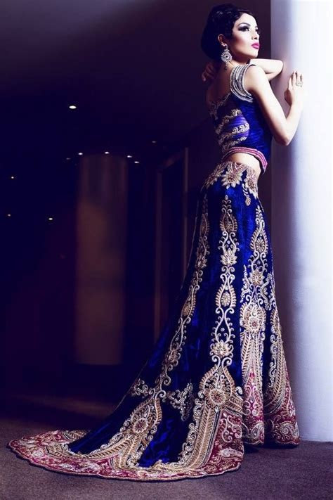 A gorgeous winter wedding lengha in royal blue and gold