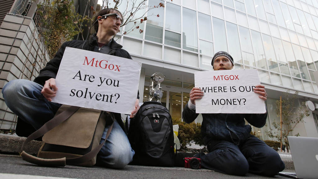 Protesters outside bitcoin exchange Mt Gox headquarters (picture: Reuters)