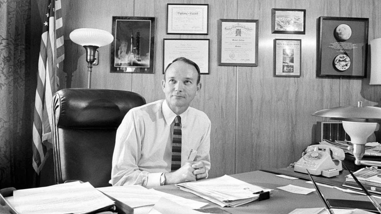 Mike Collins, the third man of the Apollo 11 moon landing mission, sits at his State Department desk in Washington, US. Image: AP.