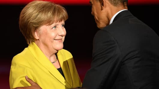 U.S. Barack Obama greets German Chancellor Angela Merkel at the opening evening of the Hannover Messe trade fair on April 24, 2016 in Hanover, Germany.