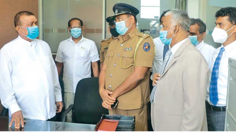 Lands Minister S.M.Chandrasena at the new police unit.