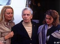 Karajan steps off the jet with his wife, Eliette (left) and daughter Isabella