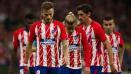 Indosport - Skuat Atletico Madrid tertunduk lesu.