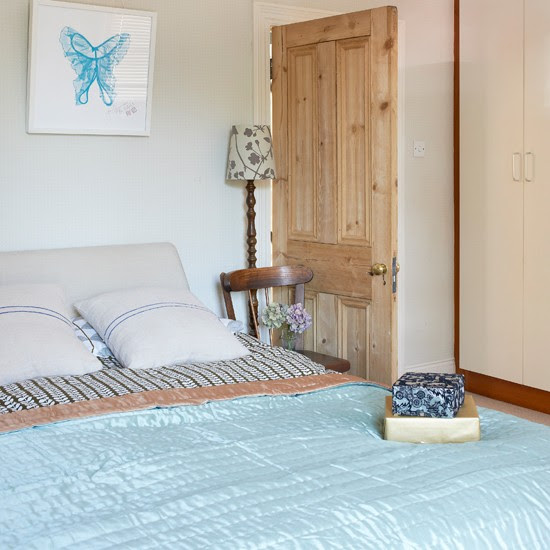 Cream bedroom with pale blue accessories