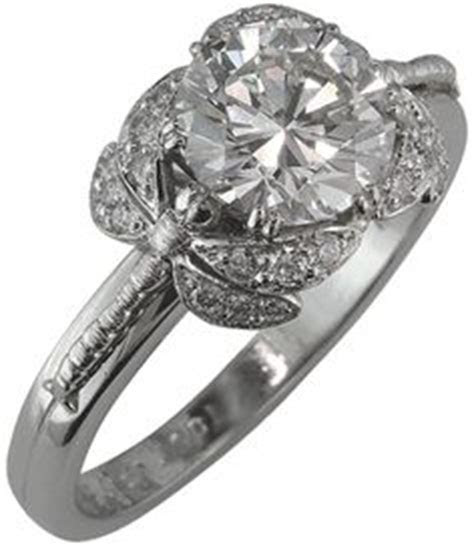 14K White Gold Diamond Dragonfly Ring .11 carats please