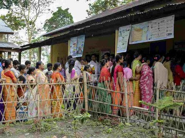 Voters stand in a queue during the Lok Sabha poll. File image. PTI