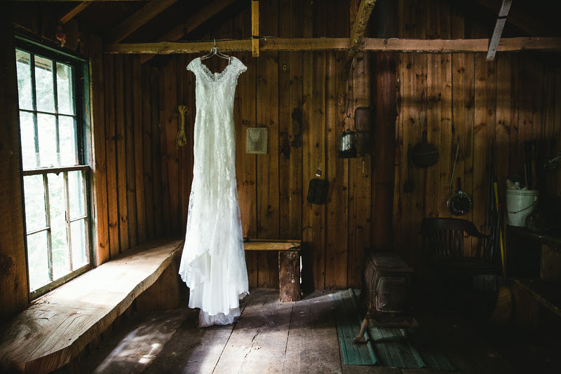 Wedding Dress and Cowgirl Boots at the log cabin at Williams Tree farm in Rockton IL, Located about 20 minutes north of Rockford IL. The Wedding was a anniversary and vow renewal held for friends and family. They had many DIY and rustic country elements in their wedding and reception. Photo by Mindy Joy Photography