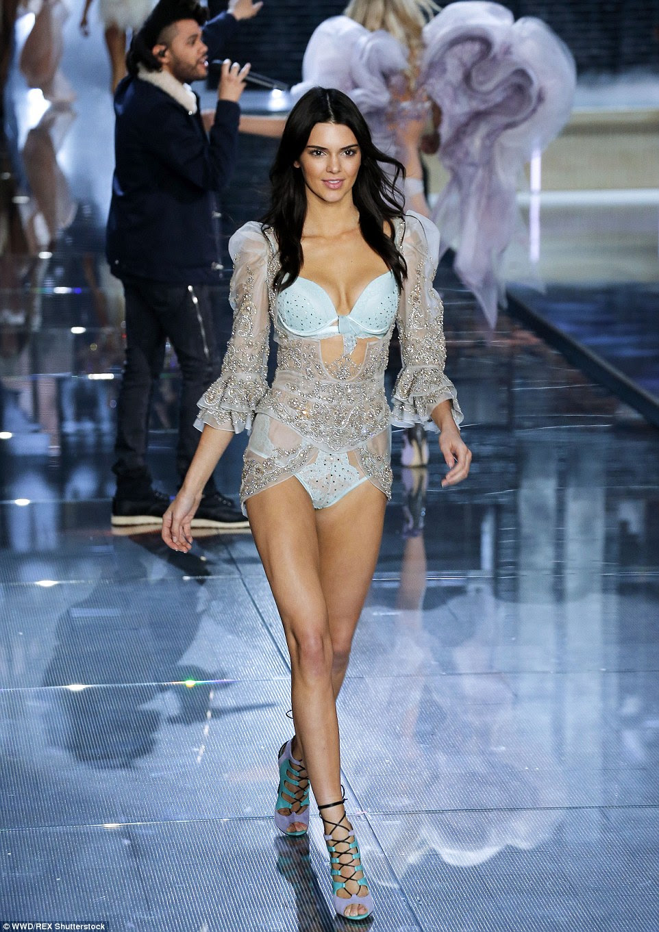 Blue belle: Kendall showed her fashion week experience as she sashayed down the runway in a pale blue diamante number