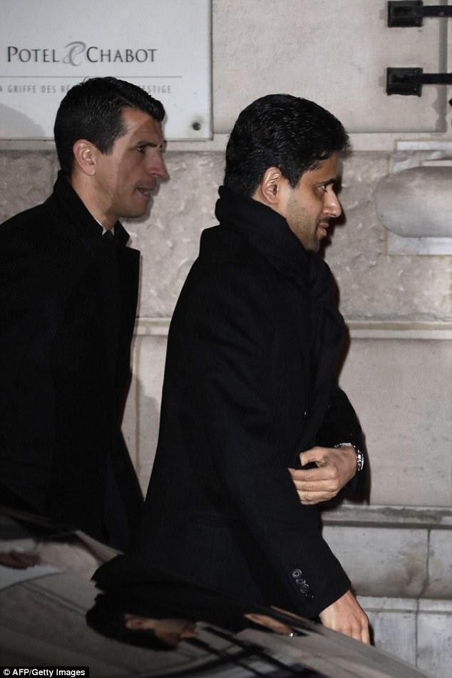 Glitzy bash:Paris Saint-Germain's Qatari president Nasser Al-Khelaifi wrapped up in a black scarf and blazer as he anticipated the celebrations
