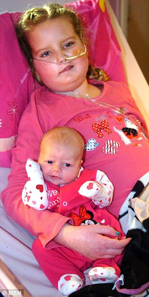 Me and my little sister: Katy Holmes, from Lancashire, cuddles baby Scarlet, the baby her mother delivered early so that she could meet her before she succumbs to an inoperable terminal brain tumour