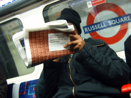 Taking an odd Tube photo of the odd Tube photo ad