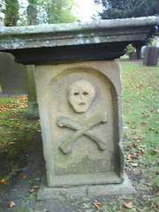 Picaresque grave in the grounds of the Church of St Lawrence, Eyam