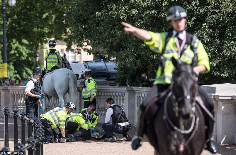 Security was on high alert around Buckingham Palace today and police arrested a man  in possession of a knife