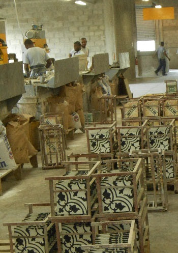 Cement tiles are placed on metal racks to dry after made