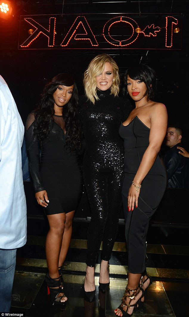 Twinning! Malika (R) and Kahdija (L) matched Khloe's monochromatic style in black ensembles of their own