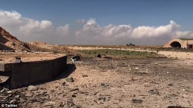 Pictures show rubble strewn across the airfield at the Syrian military base this morning. The Syrian Army called it an 'act of 'aggression'