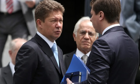 Chief executive of Russian energy company Gazprom, Alexey Miller (L), leaves the Maximos mansion after a meeting with Greek prime minister Antonis Samaras. Photograph: EPA/Alexandros Vlachos