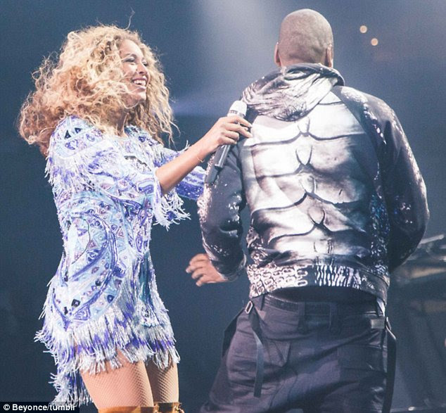 Stunned: Beyonce was clearly just as surprised as the audience, who roared with applause at the liplock