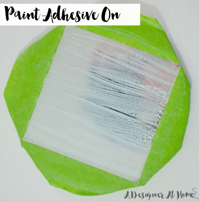 paint a thin layer of adhesive