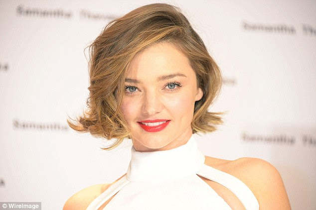 Tousled tresses: Featuring a sweeping side-parting, Miranda's new haircut featured a flicked-over fringe, while her sunkissed brunette locks were given a 'bedhead' look thanks to the ends being carefully teased out
