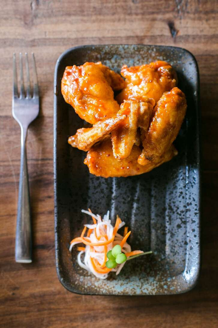 "FuseBOX serves their own version of ""KFC"" with chicken wings dipped in a rice flour batter and covered in a spicy sauce."