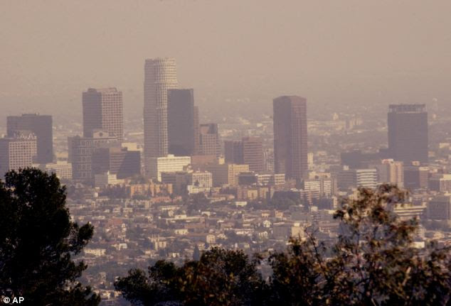 Unhealthy: Smog-filled air over Downtown Los Angeles is an example of how our fossil-fuel-burning civilisation is not doing our lungs any favours