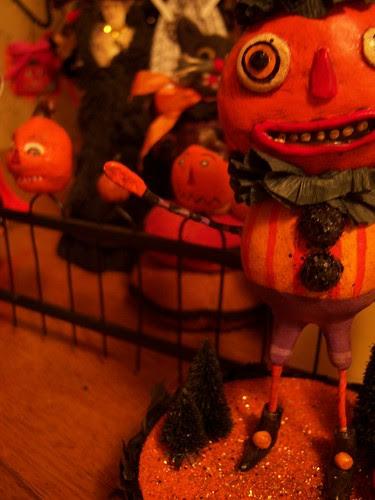 pumpkins beckon from the gate