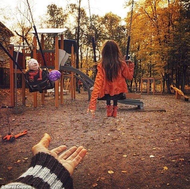 In the swing: This is the first picture in the collection where their hands are not touching